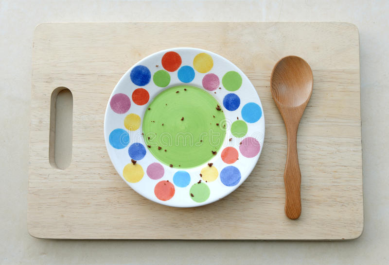 Dirty Plate, Spoon on wooden plate.Top View Text Space royalty free stock photography