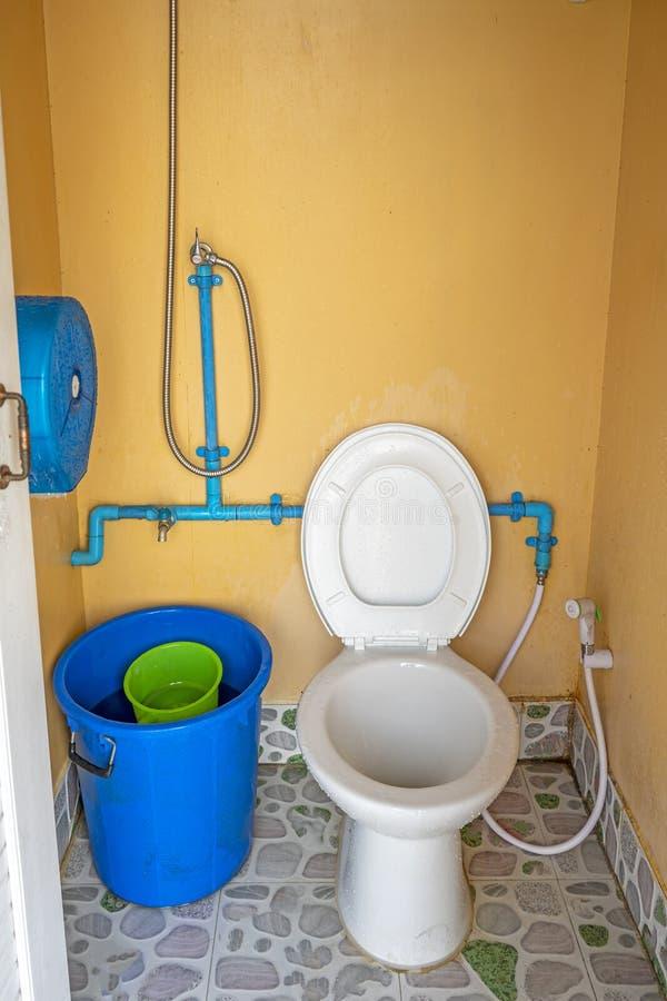 Dirty public toilet on comfort open door.  stock photography