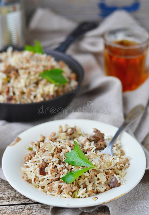 Dirty rice with ground beef. Dirty rice is a delicious traditional Cajun rice dish which is made dirty from the brown color of chicken liver and gizzards. It is stock photos