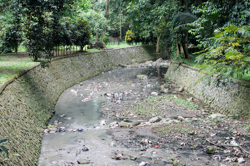 Dirty river in Bogor, Indonesia.  royalty free stock image