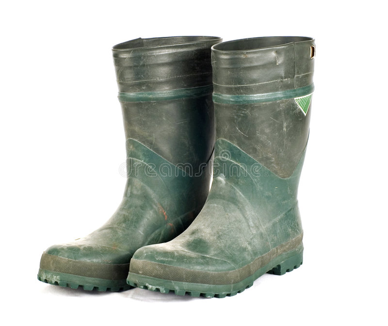 Dirty Rubber Work Boots stock photos
