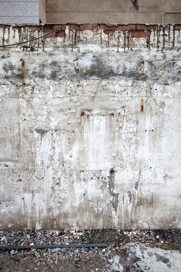 A dirty and ruined wall. Vertical background. stock photography