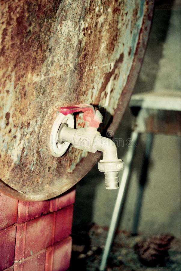 Dirty, rust faucet royalty free stock image