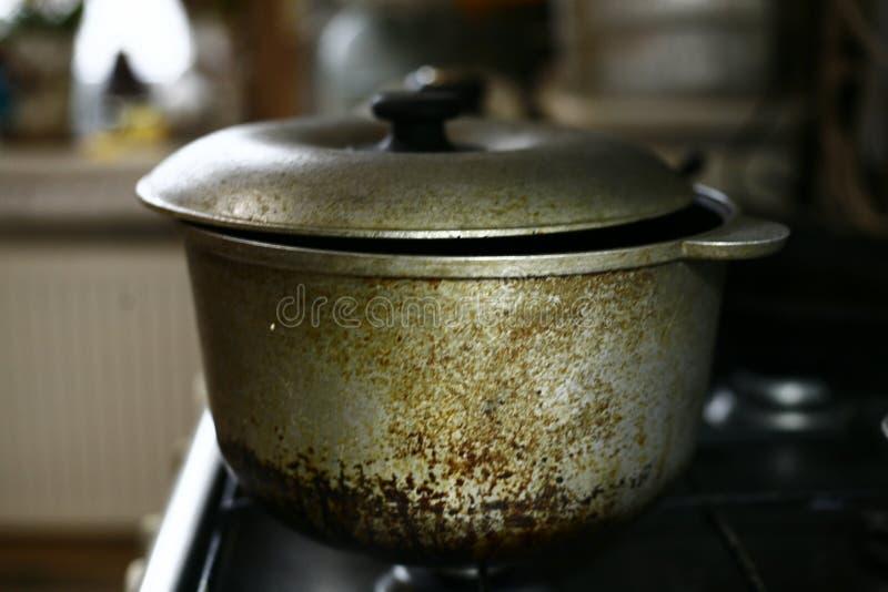 Dirty saucepan on the stove royalty free stock photos