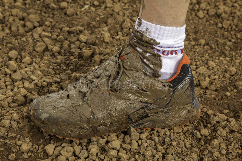 Dirty shoe. Sneakers on mud stock photo