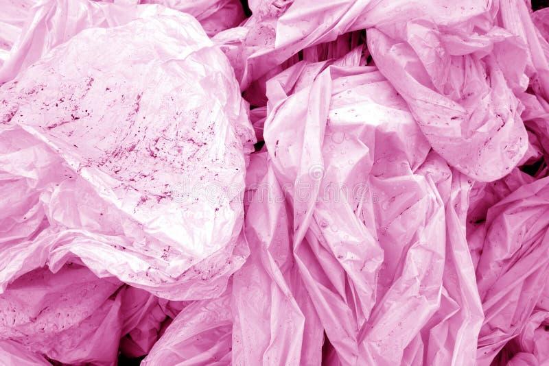 Dirty skrynklade pvc i rosa signal royaltyfri bild