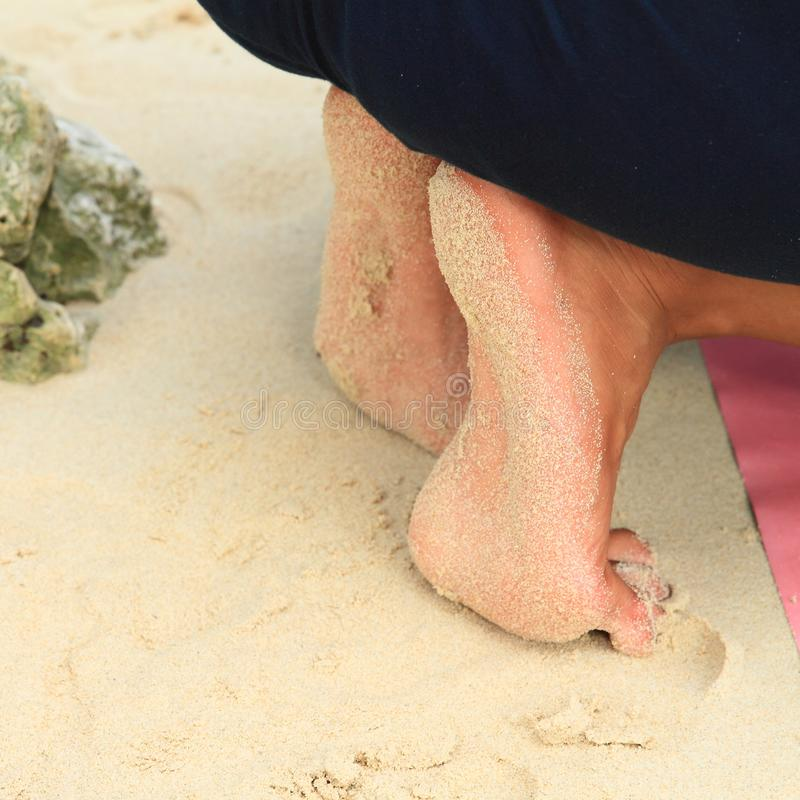 Dirty soles of bare feet. Of young woman covered with sand of sandy beach. Body part royalty free stock photos
