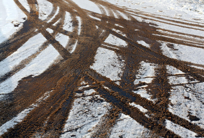 Dirty tire tracks on snow. royalty free stock photo