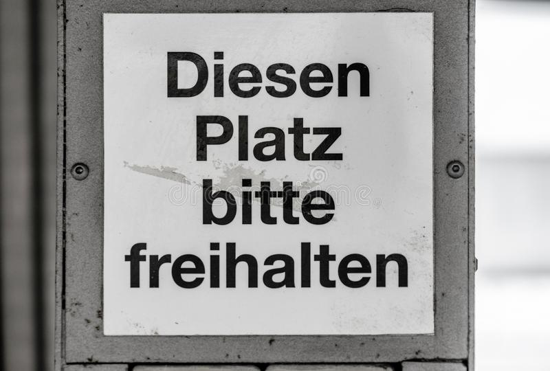 Dirty and ugly sign at a station with the German inscription. `Keep this place clear`, Germany stock photography