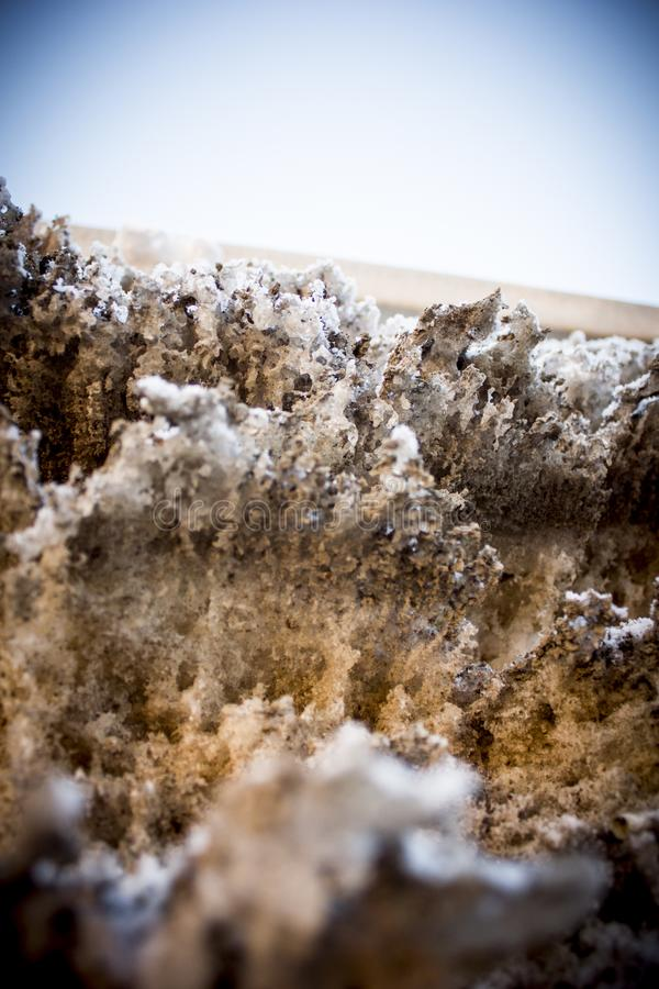 Dirty unclean snow, winter in city stock image