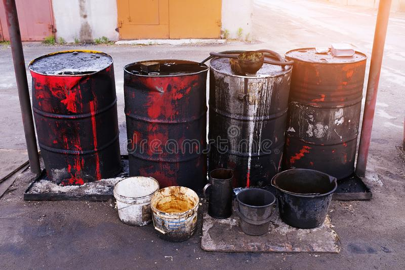 Dirty used colorful oil drums are modified to look like garbage cans in the engine room. Used engine oil in large barrels, buckets. Or containers. Environmental royalty free stock photography