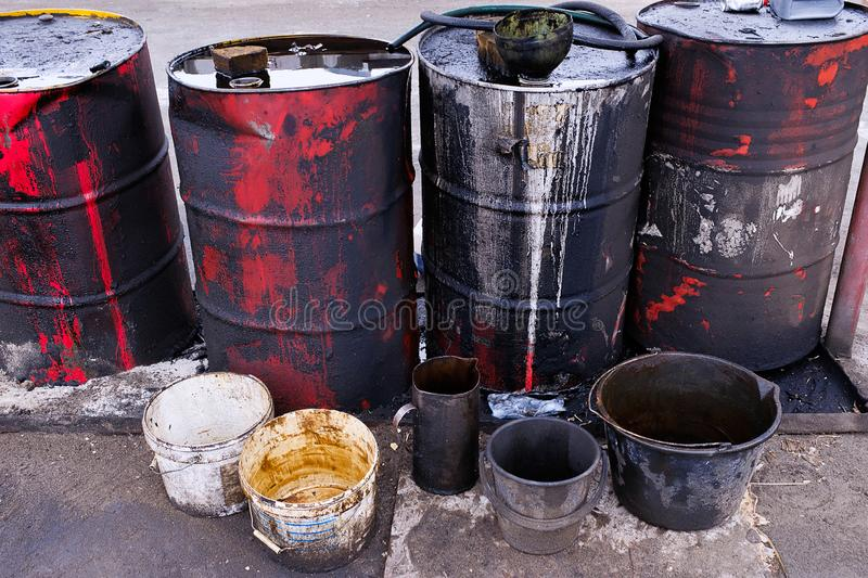 Dirty used colorful oil drums are modified to look like garbage cans in the engine room. Used engine oil in large barrels, buckets. Or containers. Environmental stock image