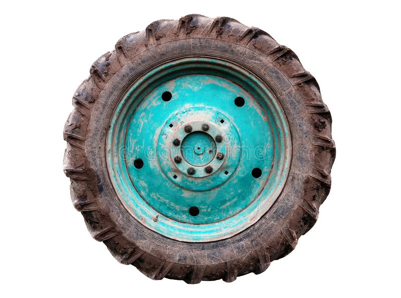 Dirty used tractor wheel on white royalty free stock photo