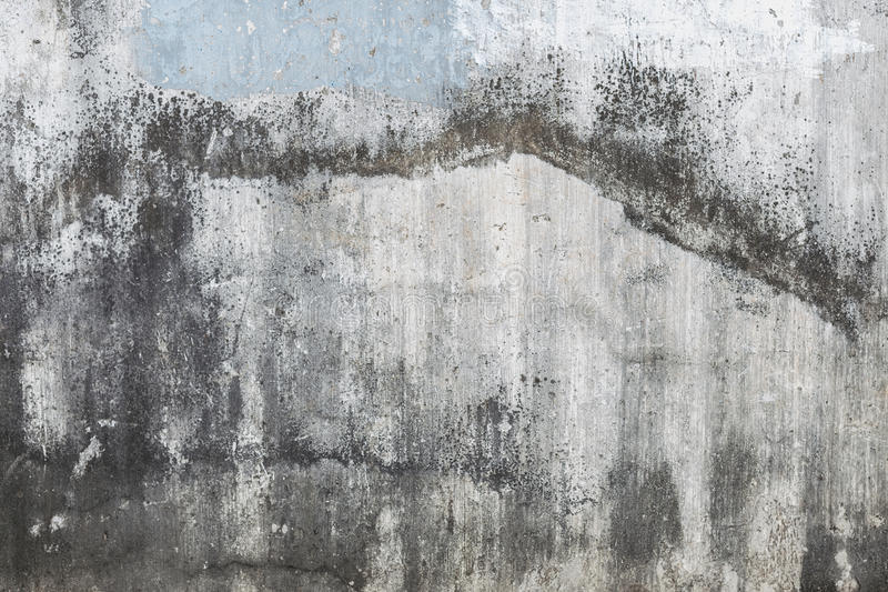 Dirty wall with streaks, leafless paint peeling off and figures. Fragment of wall with dirty smudges, leafless paint peeling off and figures. Textured grunge royalty free stock photography