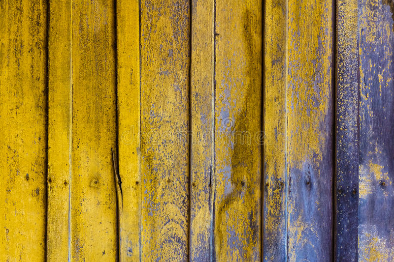 Dirty wall. Dirty wood wall with yellow color stain stock images