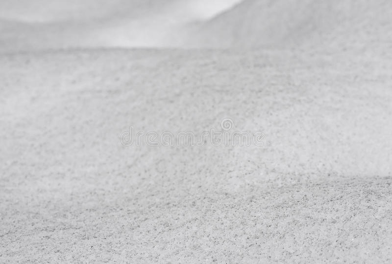 Dirty wavy snow surface background, bumpy land covered by newly-fallen snow closeup, selective focus, shallow depth of field royalty free stock images