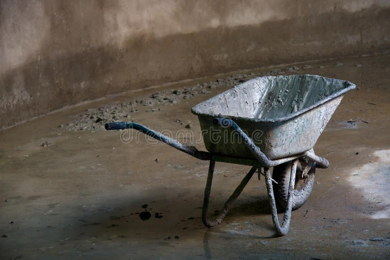 Dirty wheelbarrow royalty free stock photo