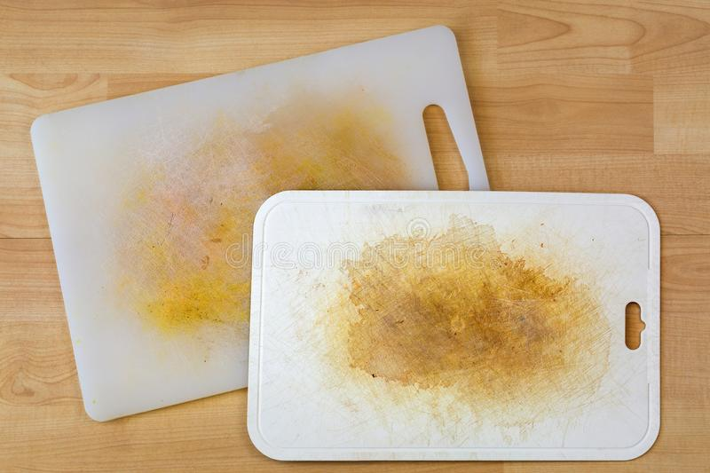 Dirty white plastic cutting board with dark stains, scratch royalty free stock images