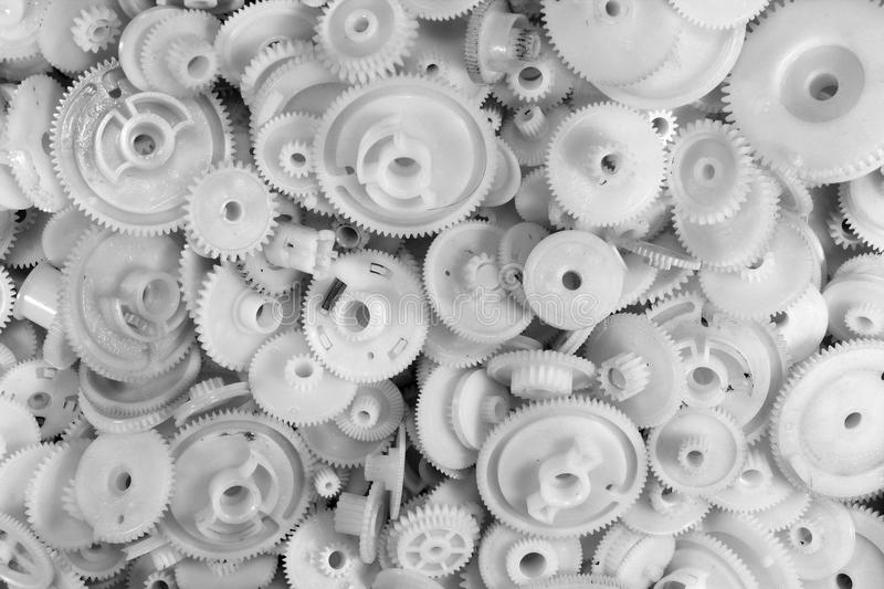 Dirty white plastic gears and cogwheels royalty free stock images