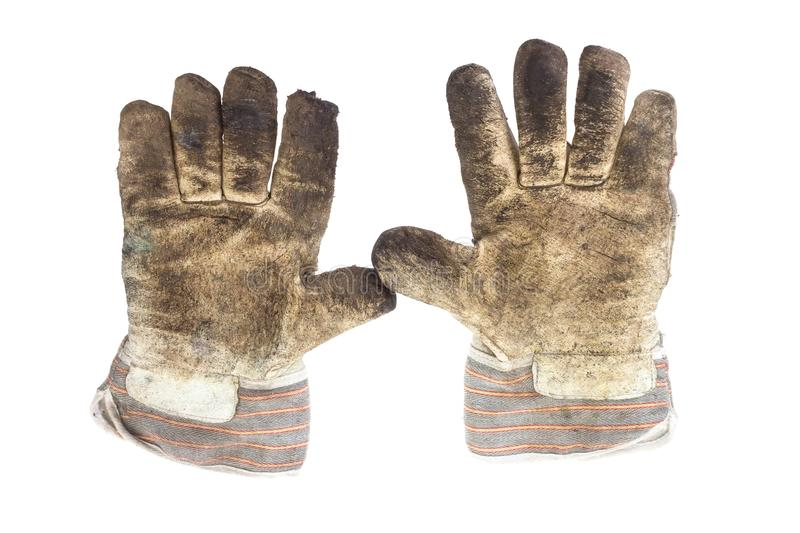 Dirty working gloves. A pair of dirty working glove palms on white background stock photos