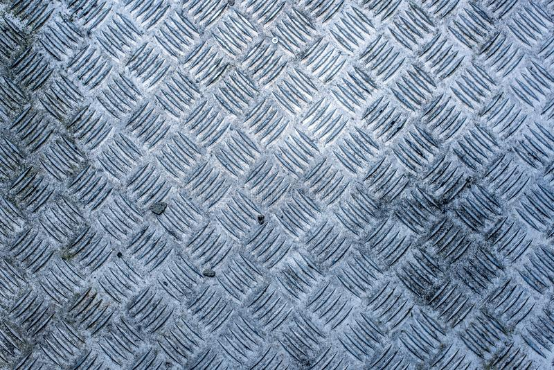 A dirty, worn and weathered diamond plate royalty free stock image
