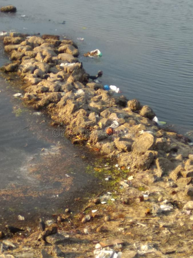 Dirtyness au bord de la mer photographie stock