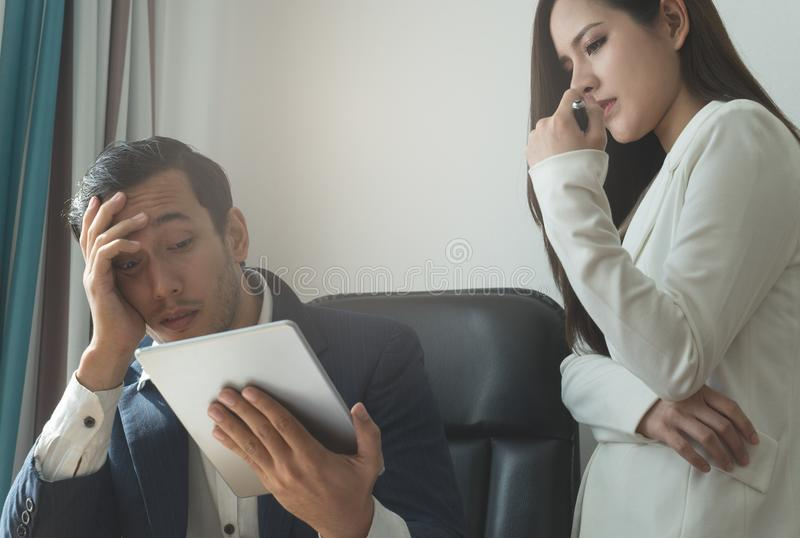Disaapointed Boss business manager looking at Tablet failure royalty free stock image