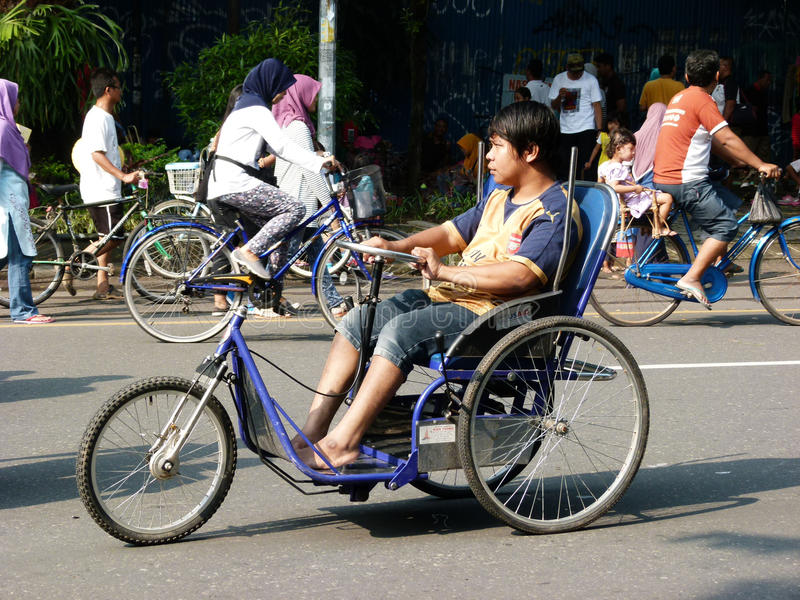 Disabilities. Adolescents with disabilities move in a public space in the city of Solo, Central Java, Indonesia stock photography