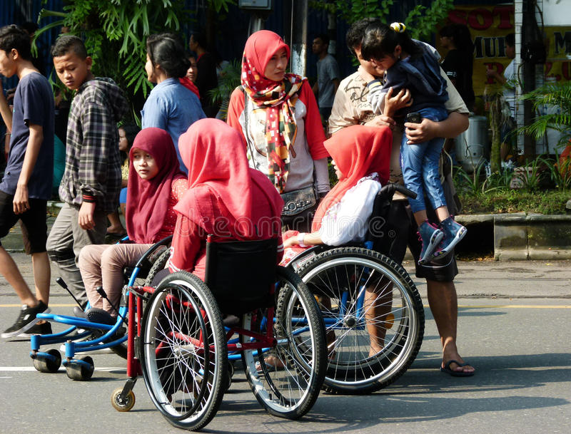 Disabilities. Adolescents with disabilities move in a public space in the city of Solo, Central Java, Indonesia royalty free stock images