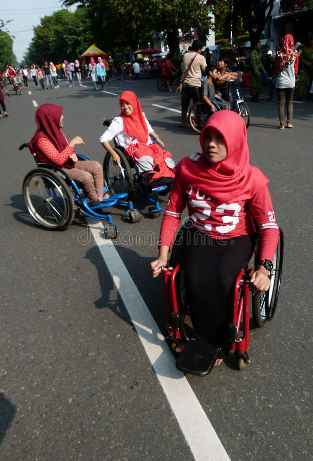 Disabilities. Adolescents with disabilities move in a public space in the city of Solo, Central Java, Indonesia royalty free stock photos