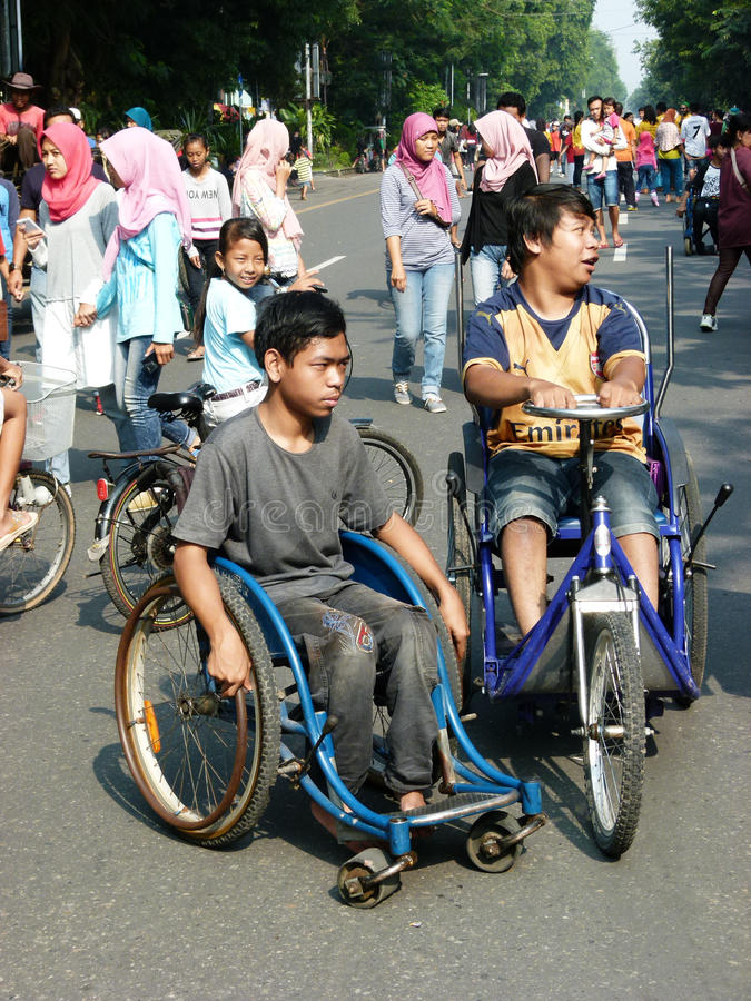Disabilities. Adolescents with disabilities move in a public space in the city of Solo, Central Java, Indonesia royalty free stock image