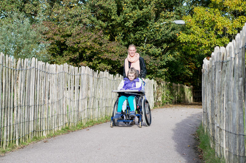 Disabled girl in a wheelchair relaxing outside stock photography