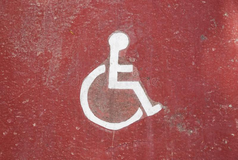 Disability icon on grunge background, floor of underground garage . stock photos