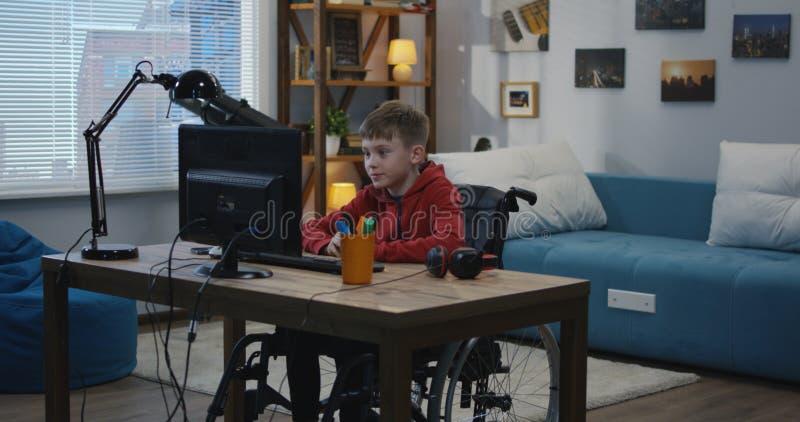 Disable boy having video call stock photo