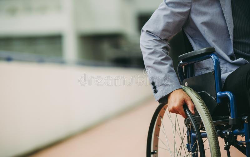 Disable businessman on wheelchair. After car accident and rehabilitation, a businessman can return to work again.The company which employing disable people will royalty free stock photography