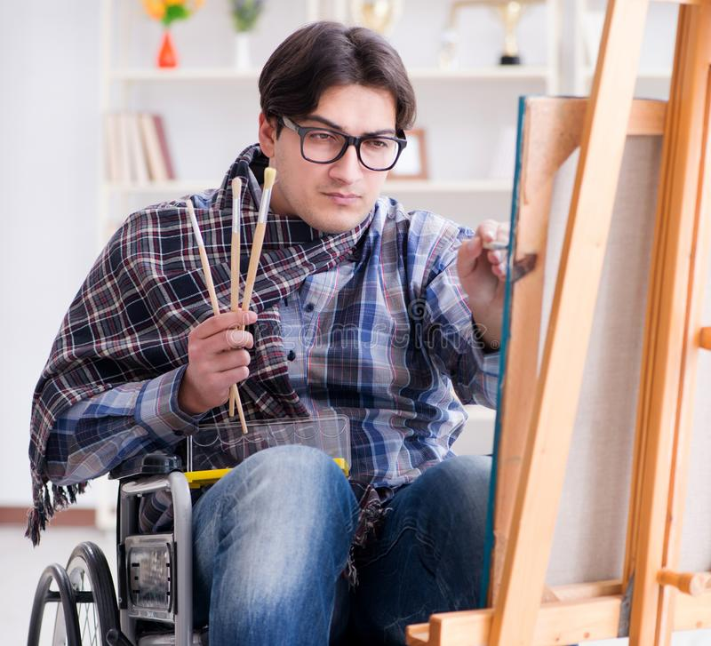 Disabled artist painting picture in studio. The disabled artist painting picture in studio stock images