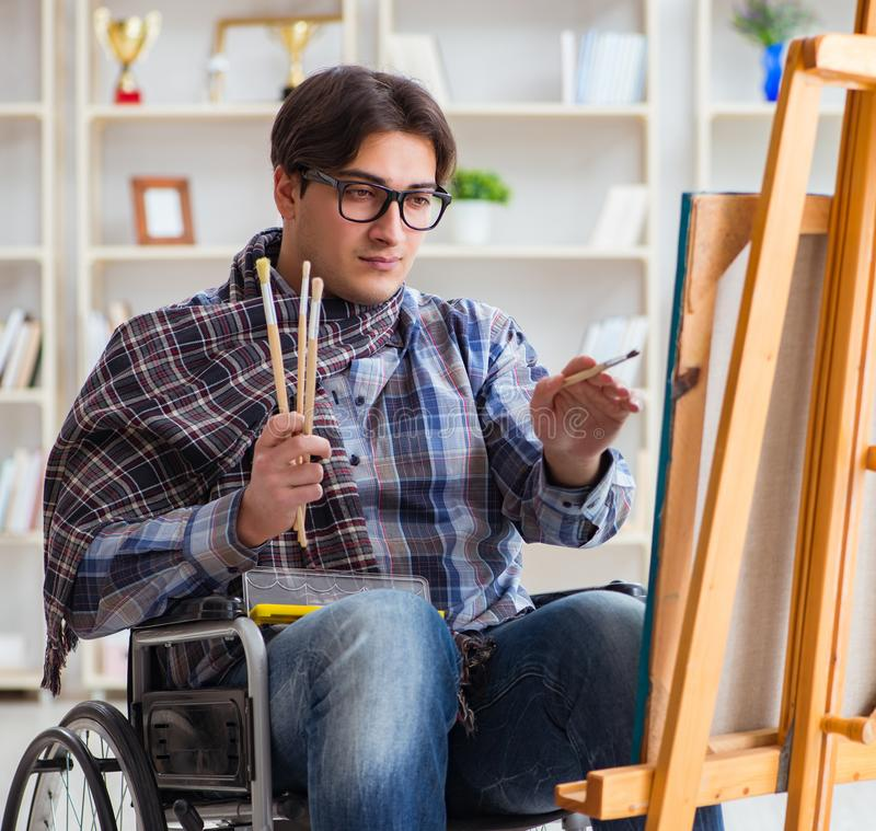 Disabled artist painting picture in studio. The disabled artist painting picture in studio stock photo