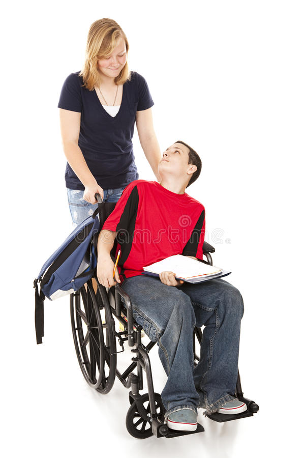 Disabled Boy and Friend. Teen girl pushing her disabled friend in his wheelchair. Full body isolated