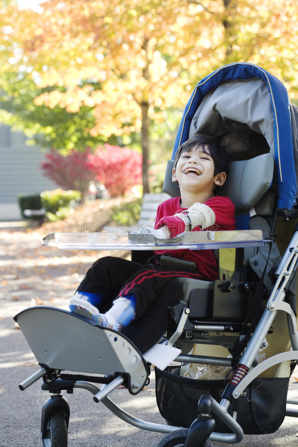 Download Disabled Boy In Medical Wheelchair At Park Stock Image - Image: 17432551