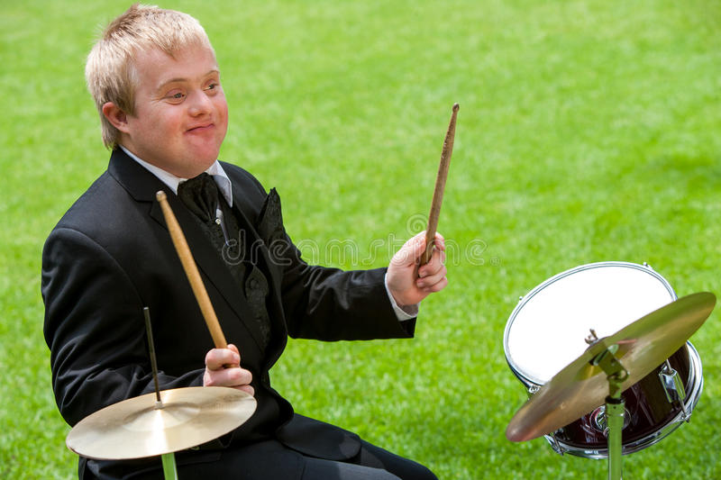 Disabled boy playing drums. stock images