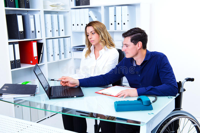 Disabled business man and his female colleague royalty free stock photos