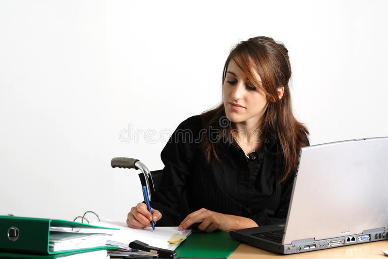 Disabled business woman at her desk stock photography