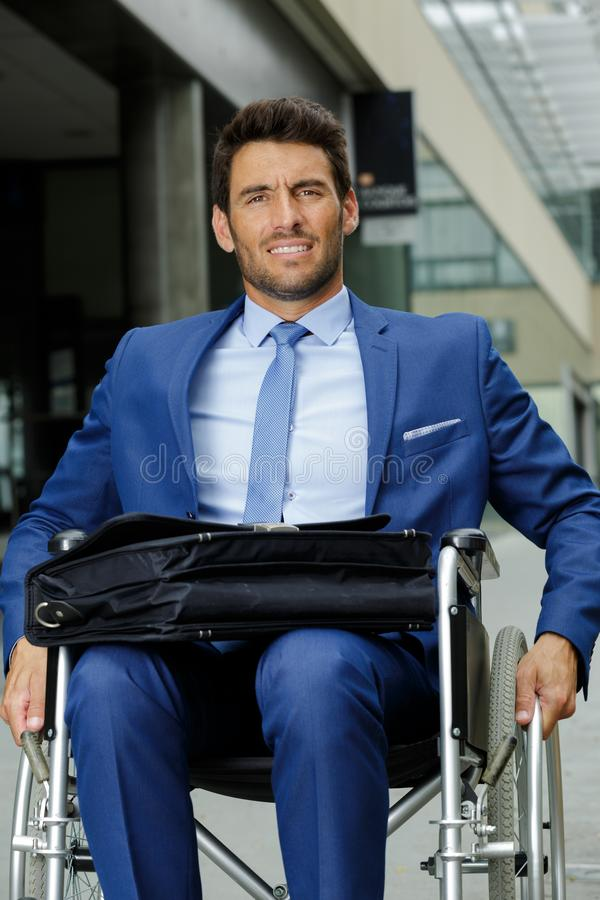 Disabled businessman in wheelchair royalty free stock photo