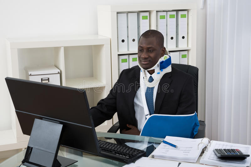 Disabled Businessman Working In Office. Portrait Of Young Disabled African Businessman Working In Office royalty free stock photo