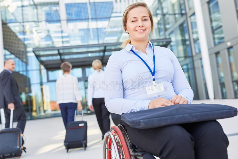 Businesswoman in a wheelchair on arrival to the congress. Disabled businesswoman in wheelchair on arrival to congress on inclusion stock photography