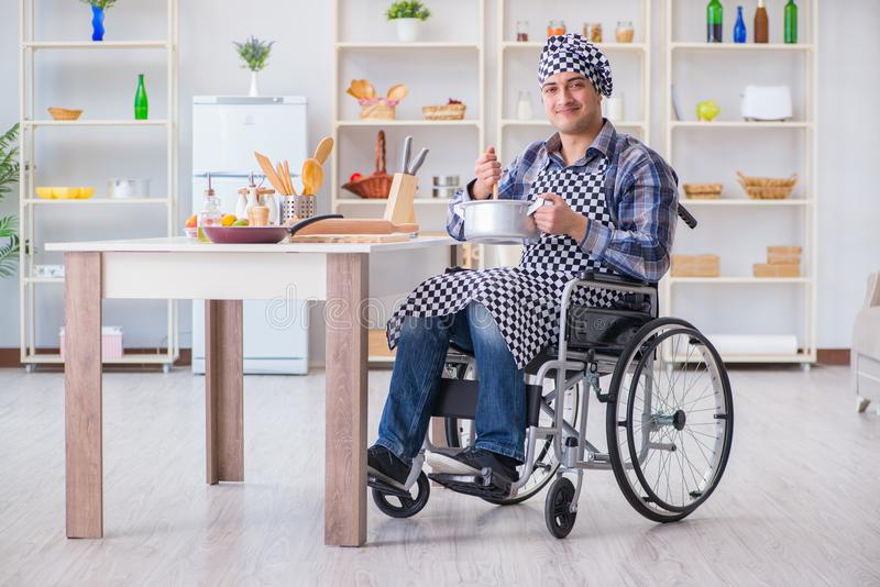 The disabled cook on wheelchair in cooking concept stock images