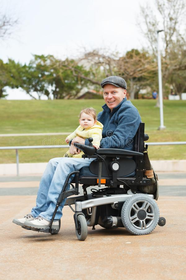 Disabled dad play with son royalty free stock photos
