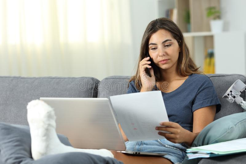 Disabled freelancer working at home stock photography