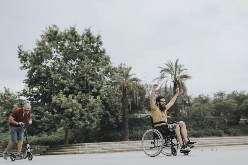 Disabled Happy friends having fun together outside stock images