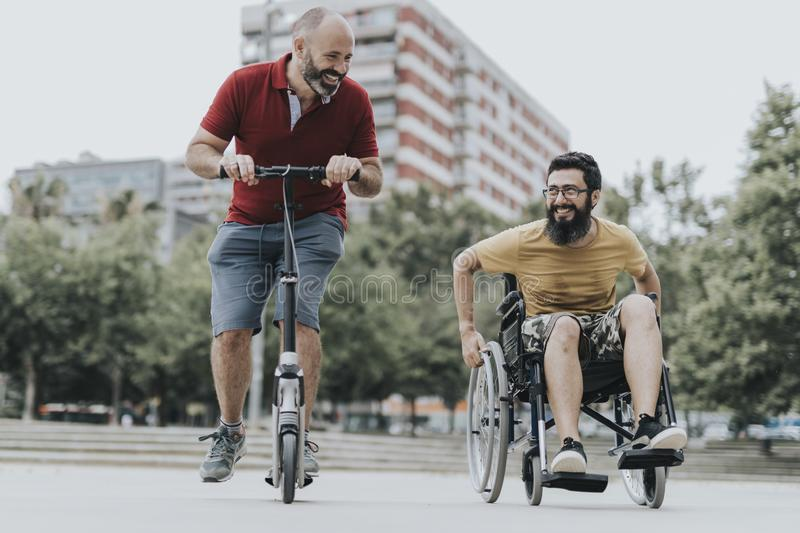 Disabled Happy friends having fun together outside stock image